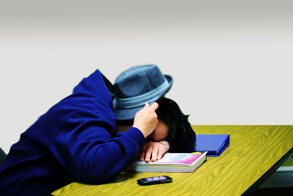Picture of student asleep on desk